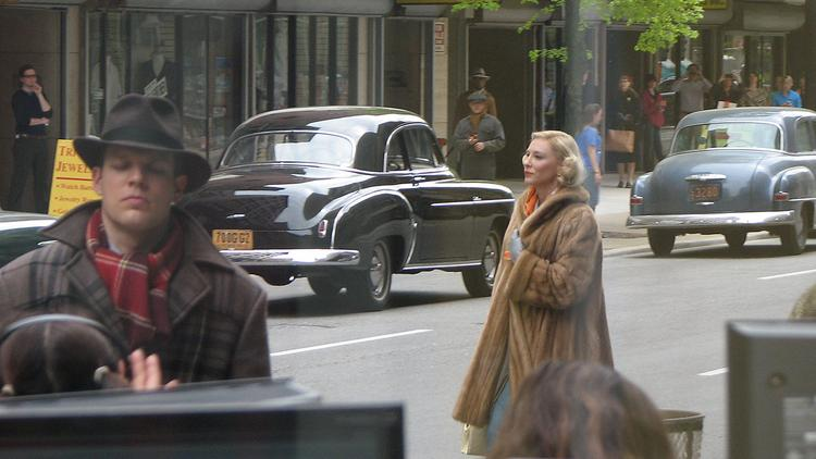 Cate Blanchett walks on set for filming outside the Business Courier's office.