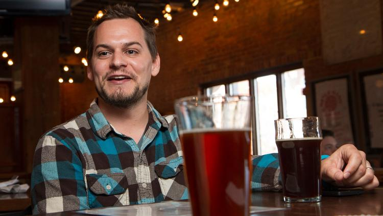 Chad Smith, a developer at Sullivan Higdon & Sink, talks at River City Brewing Co. about his home brewing hobby.