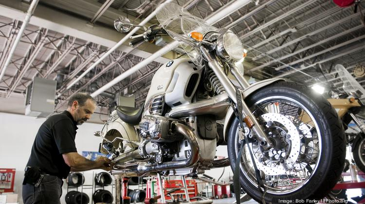 Bob Farley/f8Photo.org --Glenn West works on a 1998 BMW R1299C crusher in the service area of BMW Motorcycles of Birmingham at their new location in the old Sears automotive building at Century Plaza.