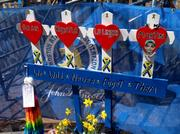 A memorial at the 2014 Boston Marathon for the four people killed in last year's bombings.
