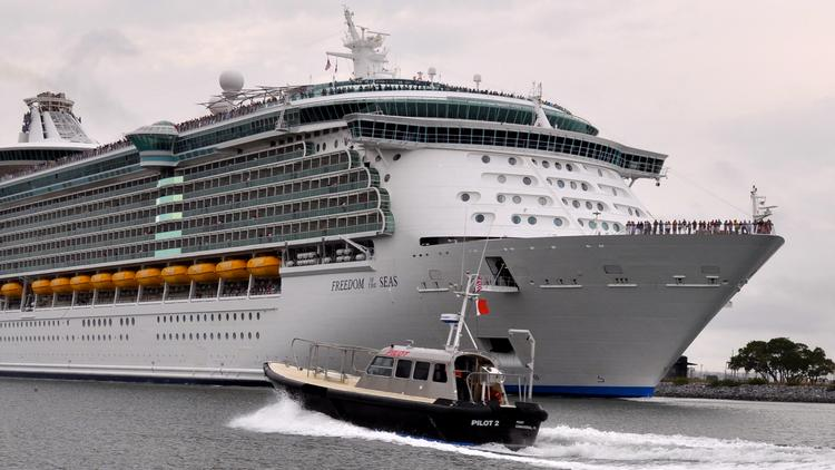 Royal Caribbean's Freedom of the Seas in the main channel of Port Canaveral