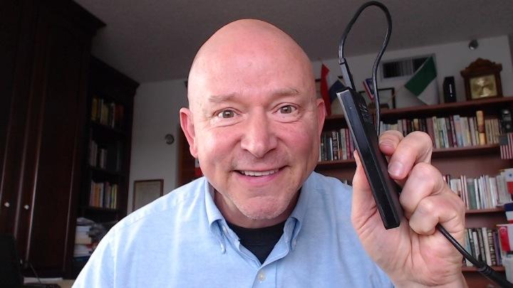 Terry Brock holding his new 2-terabyte external hard drive. It's thin and costs $120.