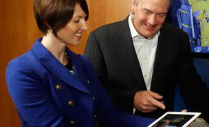 Brooke Aguilar, vice president of global business development for Fluid checks out the Expert Shopper (XPS) app made with IBM Watson alongside Michael Rhodin, senior vice president of the IBM Watson Group.