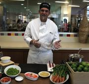 eBay chef Kris Wisdom lays out the ingredients for edamame burgers topped with sumac-spiced carrot peels.