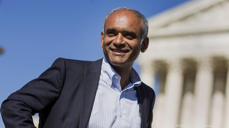 Aereo CEO Chet Kanojia talks to reporters outside the U.S. Supreme Court in April, when the court heard broadcasters' case against his company.