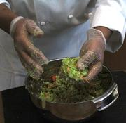 Time to make burgers: eBay chef Kris Wisdom of Bon Appetit Management shapes edamame, millet, carrots and other ingredients into burger patties.