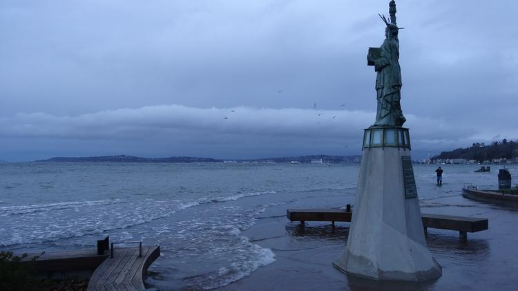 In 2010, an unusually high tide in West Seattle, where this Statue of Liberty replica is located, flooded the Barton and Murray pump stations.