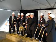 U.S. Rep. Jim Moran, (center, holding the dirt), with Arlington Board Chairman Jay Fisette to Moran's right, Metro's Stan Wall, to Moran's left, and JBG principal Andy VanHorn (pointing fingers) join others to break ground on Central Place in Rosslyn.