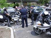 Police meet on strategy in the driveway of the Business Journal parking lot on X Street. The Business Journal has a good view of the traffic backing up and rerouting for Highway 50 during the Fix 50 project.