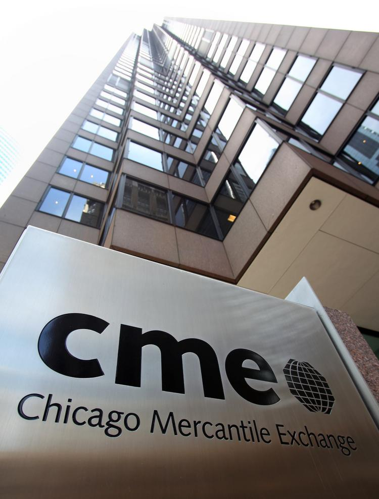 A Chicago Mercantile Exchange sign is seen outside CME Group Inc.'s headquarters in Chicago. CME Group is the world's largest futures and options exchange.