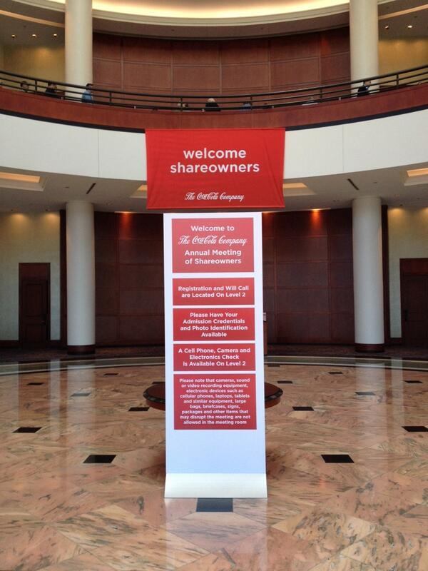 A sign welcomes shareholders to The Coca Cola Company's annual meeting at the Cobb Galleria Centre in Atlanta.