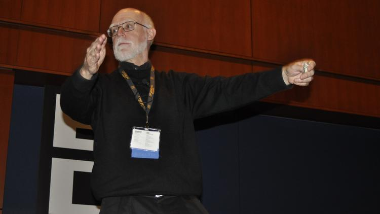 Ken Rolston, director of design at Turbine, dances in front of the East Coast Game Conference crowd Wednesday at the Raleigh Convention Center.