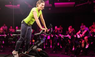 Marion Roaman, who sold her own boutique bicycling class to Flywheel is back on the founders scene with Peloton, a different kind of exercise venture that involves cyclists at home, and some who will ham it up in a New York City studio. Meet her co-founder and see the headquarters in the next slide.