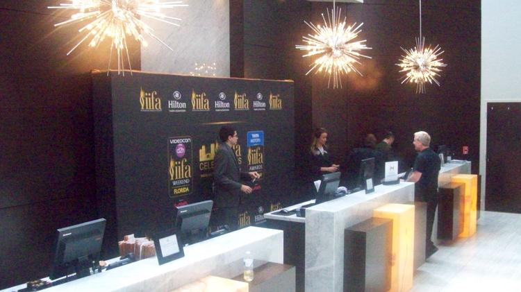 IIFA signage at Hilton Downtown Tampa check-in desk.