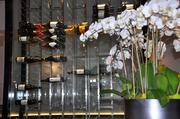 The floor-to-ceiling wine rack is a centerpice of Tala American Bistro.