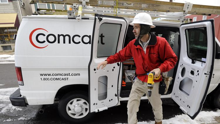 Randy Groves, a Comcast Corp. field service technician, arrives to install cable service at a residence in Reading, Pennsylvania, U.S., on Wednesday, Jan. 19, 2011.