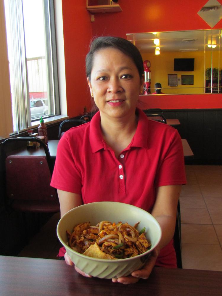 Christin Tan, co-owner of Big Bowl Asian Bistro with her husband Kenny Tan, moved to Dayton from Malaysia.