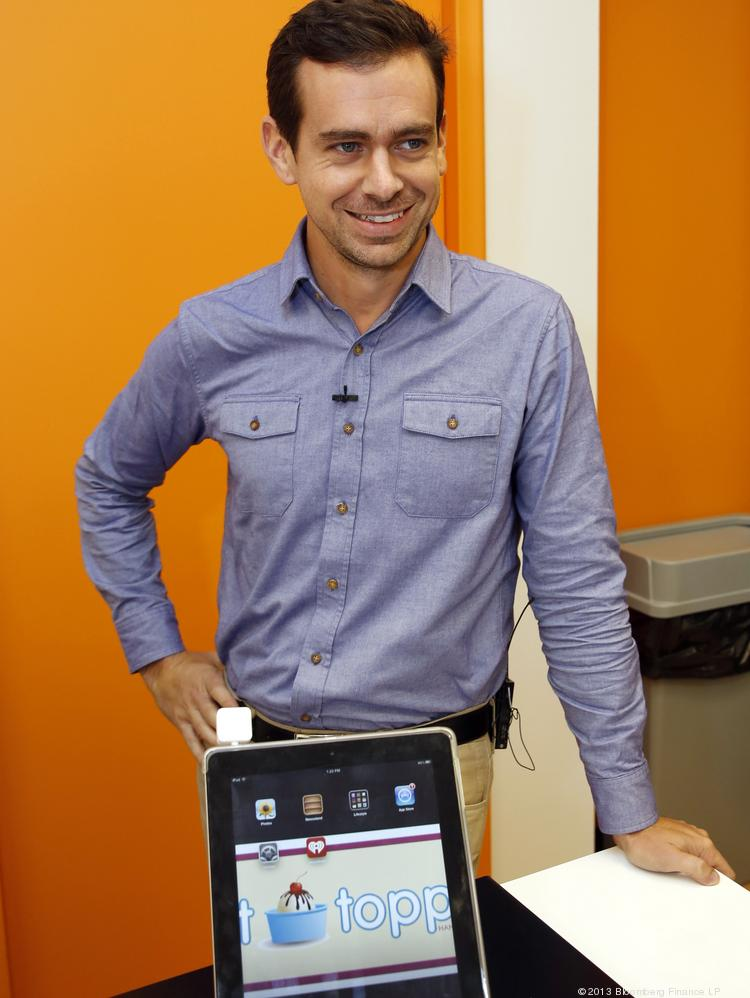 Jack Dorsey, co-founder and chief executive officer of Square Inc., stands for a photo with his company's device in Detroit.