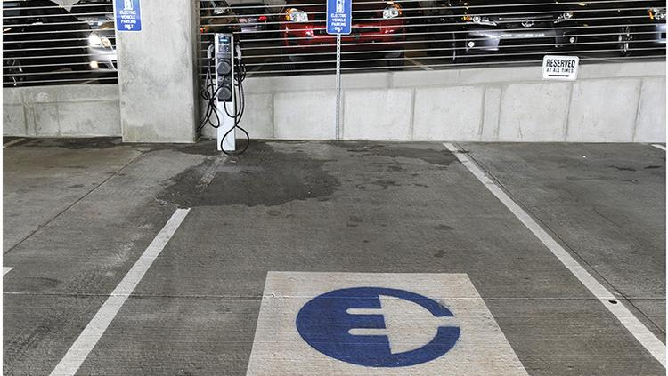 Electric cars can get their charge in the parking garage of AMC's new Theatre Support Center.