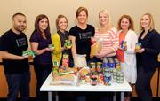 Lionakis' Jonathan Nep, Elena Livanis, Colette Carty, Kristin Balukoff, Emily Clark, Cari Sullivan and Ashley Kenneally donated a pound of food to the Sacramento Food Bank for every pound they lost.