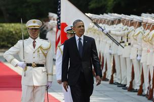 U.S. President Barack Obama, center, inspects an honor guard during a welcoming ceremony at the Imperial Palace in Tokyo, Japan, on Thursday, April 24, 2014. Obama arrived in Japan yesterday to start a four-country tour of Asia aimed at advancing a Pacific-nations trade pact and reassuring allies the U.S. will back their security interests, including in territorial disputes with China.