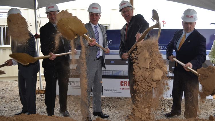 Gov. Jay Nixon (second from right) and Daniel Infusino (third from right), executive vice president of Martinrea International Inc., participate in groundbreaking ceremonies for company's new 275,000-square-foot, 290-job facility in Riverside.