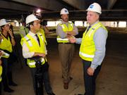Greg Noble, Galleria general manager, gives a tour of the current construction. He is standing in the existing underground parking lot of Macy's, which will get new striping and columns.