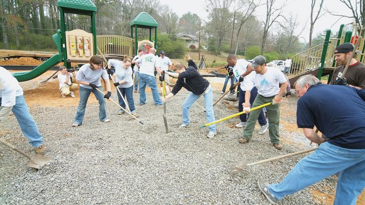 Alabama Power Co. employees working on one of the company's many volunteer projects.