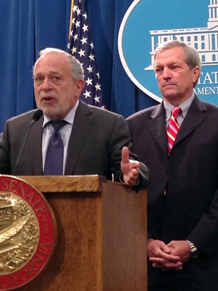 Former U.S. Secretary of Labor Robert Reich, left, stands beside Sen. Mark DeSaulnier, D-Concord in the Capitol on Thursday. Reich was on hand to help promote Senate Bill 1372, which would raise state taxes on publicly traded companies that pay their top-earning employee 100 times as much or more as the company's average worker.