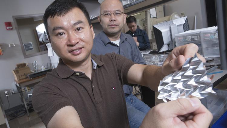Hanqing Jiang, left, adn Hongyu Yu in their lab at Arizona State University, where they are experimenting on a flexible battery, allowing for use in personal electronic devices.