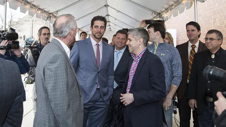 University of Wisconsin-Madison basketball coach Bo Ryan, Green Bay Packers quarterback Aaron Rodgers and ESPN Milwaukee president Craig Karmazin chat before the Wisconsin Sports Awards.