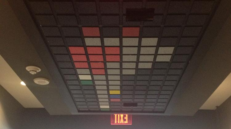 The funky ceiling has a story. It was originally going to be a digital front desk that would interact with people when you got off the elevator. It was going to ask who you were here to see, bring up a picture and then call them for you. Apparently the fire marshal had some issue with it. Ugh. Rules.