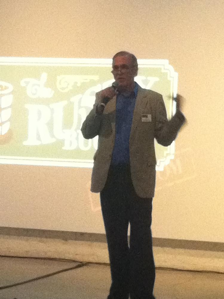 John Demers of Rusty Bucket Kids at an investment pitch.