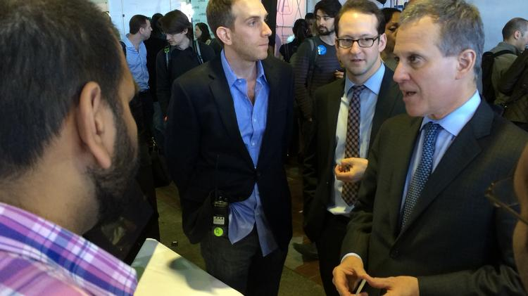 New York Attorney General Eric Schneiderman (right) talks to employees of Animoto, a video creation software company, at TechDay NYC on Thursday.