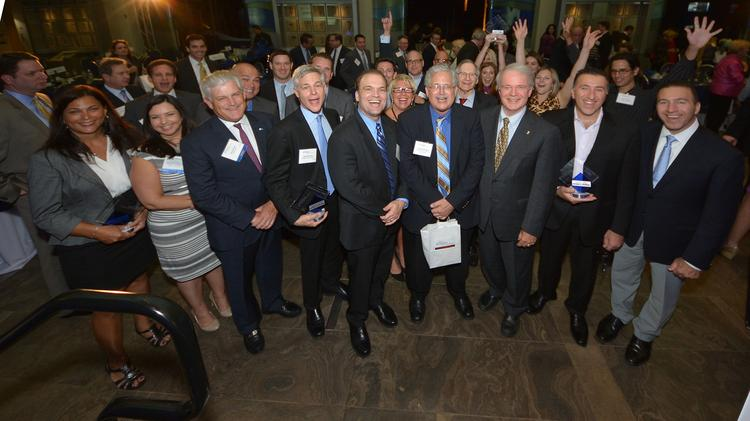 The winners, finalist, sponsors and Lifetime Achievement Award Recipient, Brian Keeley at the South Florida Business Journal 2014 Business of the Year Awards.