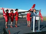 Virgin America CEO David Cush with flight attendants who donned cowboys hats to announce the move to Dallas Love Field Friday.