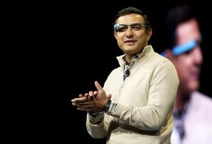 Vic Gundotra, senior vice president of engineering at Google Inc., wears Project Glass internet glasses while speaking at the Google I/O conference in San Francisco, California, U.S., on Thursday, June 28, 2012.