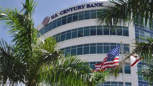 U.S. Century Bank revised its 2013 results to a $3.31 million loss.