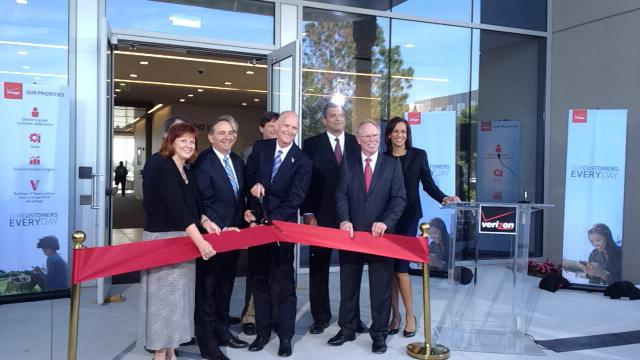 State and local officials — including Florida Gov. Rick Scott, center — were on hand with company officers to cut the ribbon to Verizon Communications Inc.'s new Center of Excellence building in Lake Mary.