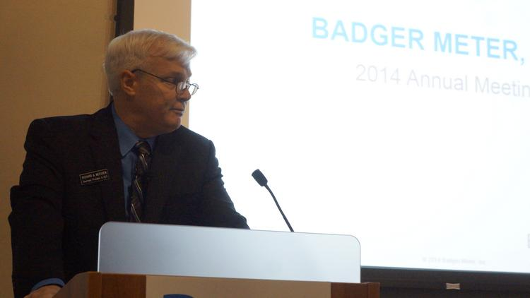 Richard Meeusen, chairman of the board, president, and chief executive officer of Badger Meter Inc., talks to his board and stockholders at an annual meeting on April 25 at the Global Water Center in Milwaukee.