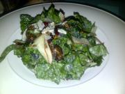Tuscan kale salad with grapes, fennel, dates and crispy farro in a pear vinaigrette