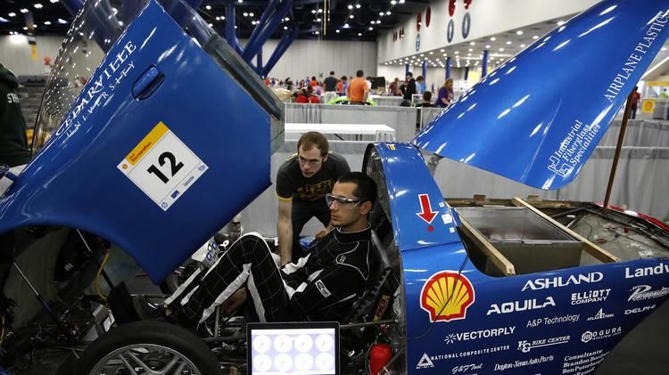 Students from Ohio's Cedarville University prepare their UrbanConcept car that runs on electric batteries for the Shell Eco-marathon competition held through April 27 in Houston.