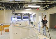 Nick Saeng with Leedco Interior Systems installed ceiling wires in space that will become Baptist Health Louisville's infusion center.