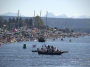 An aerial shot of boats crammed together on log booms to watch last year's Opening Day of boating season in Seattle.