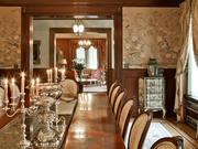 A view from the formal dining room into the music room of the historic 1914 Nathan Eckstein estate in Seattle, fully restored by the current owners. The furniture is available with this home as well, for an additional amount to be added to the selling price of $9.45 million.