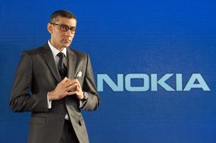 Rajeev Suri, chief executive officer of Nokia Oyj, pauses during a news conference to announce his new appointment at the company's headquarters in Espoo, Finland. Nokia named Suri chief executive officer, picking the head of its networks division to chart the company's future and forecasting a return to sales growth after selling the mobile-phone business to Microsoft Corp.