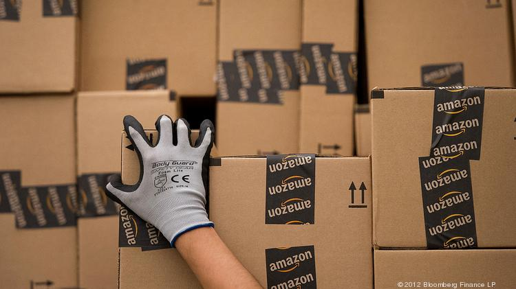 An employee loads a truck with boxes to be shipped from an Amazon distribution center.