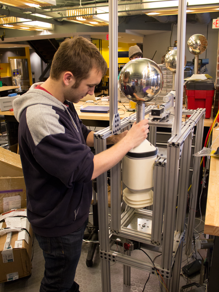 Understory co-founder Bryan Dow performs tests on a weather sensor in the engineering laboratory.