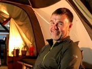 REI President and CEO Jerry Stritzke is right at home in a camp display of REI camping gear that features the comforts of home at the REI flagship store in downtown Seattle.