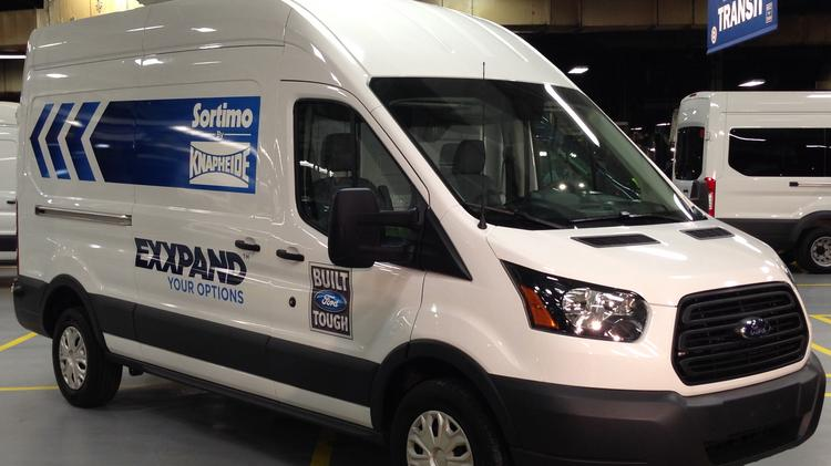 A Ford Transit van is among the first to roll off the production line at the Kansas City Assembly Plant in Claycomo.